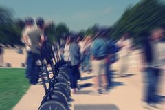 Abstract background. Tourists near the segways in the park. Pari Stock Image