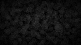 Abstract background of translucent circles. Abstract dark background of translucent circles with light outlines. Black shaded backdrop with randomly distributed Royalty Free Stock Photo