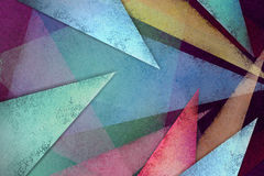 Abstract background with triangle layers in bright colorful design. Abstract black background with textured triangles and shapes layered in modern pattern in Royalty Free Stock Photo