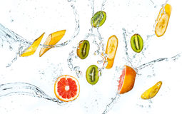 Abstract background with tropical fruits in water drops Royalty Free Stock Photography