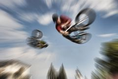 Abstract background . Two BMX bikers high up in the air. Some mo Royalty Free Stock Images