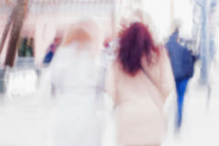 Abstract background of two girls back to us hurrying down the city street . Intentional motion blur. Concept of seasons Stock Images