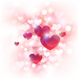 Abstract Background for Valentine's Day. With cute pink, red and white hearts in front of de-focused lights Royalty Free Stock Image