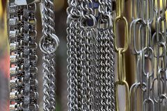 Abstract background. Various hanging metal chains. stock photo