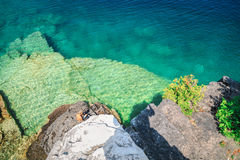 Abstract background view of  gorgeous  rocks lying  underwater of  great Cyprus lake Royalty Free Stock Images