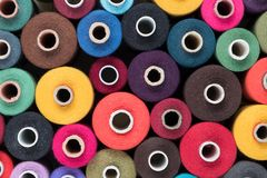 Colored sewing threads as background and wallpaper Stock Images