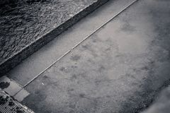 Abstract background with water and asphalt in black and white. Or monochrome Stock Images