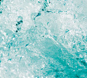 Abstract background. water wave with splashes. A photo Stock Image