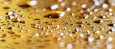 Golden water drops web banner Royalty Free Stock Photography