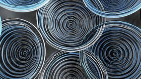 Abstract background from white, black and blue spiraled coils. Colorful wires with depth of field. 3D rendering illustration Royalty Free Stock Photography