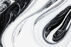 Abstract background, white and black mineral oil paint on water. Abstract background pattern texture, white and black mineral oil marble painting on water, stone Royalty Free Stock Photo