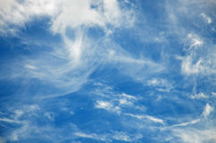 Abstract background white cirrus clouds against a blue sky royalty free stock photography