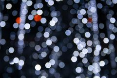 White and grey bokeh lights. Abstract background white and grey bokeh lights, frozen fountain in winter, cascade of sparks, cold feeling, coldness stock images