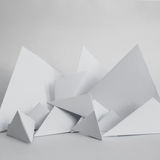 Abstract background of white paper triangles Stock Images