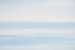Abstract background of wide stripes white clouds on blue sky royalty free stock images