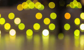 Abstract background of  yellow color lights with bokeh effect Stock Image