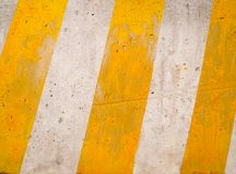 Abstract background, yellow diagonal strips on concrete weathere Royalty Free Stock Photo