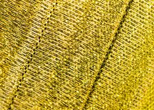Abstract background of yellow material Stock Images