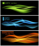 Abstract backgrounds. Shiny color waves over dark backgrounds Stock Photography