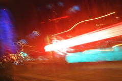 Abstract backgrounds from light streams. Flows of light from the headlights of cars rushing along and light, illumination of buildings, blurred and frozen at the Stock Image