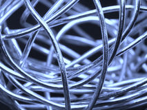Abstract ball of silver wire. Closeup of a ball of silver wire and a blueish background Royalty Free Stock Photography