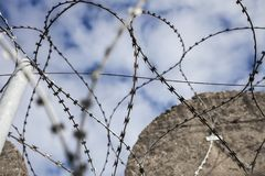 Abstract barbed wire detail of strong topwith  straight concrete Stock Photography