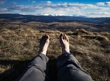 Bare feet with landscape in background Royalty Free Stock Image
