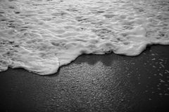 Abstract beach. Wave foam is abstract color black and white stock photo