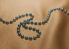 Abstract beads on a beige fabric Stock Images