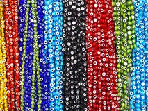 Beads hanging in blue, red, black, green colors stock photography