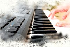 Abstract beautiful hand playing keyboard of the piano. Foreground Watercolor painting background and Digital illustration brush to art Stock Image
