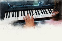 Abstract beautiful hand playing keyboard of the piano. Foreground Watercolor painting background and Digital illustration brush to art Stock Images