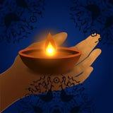 Happy Diwali Background. Burning Candle On Dark Background. Abstract beautiful Happy Diwali background. Burning candle on dark background. EPS 10 vector illustration