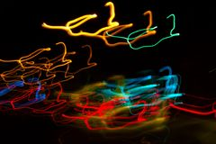 Abstract beautiful light painting photography, waves abstract light on black background. Slow shutter speed and blur-defocus technique stock image