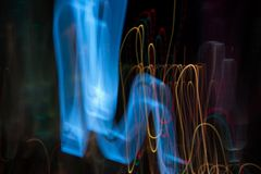 Abstract beautiful light painting photography, waves abstract light on black background. Slow shutter speed and blur-defocus technique royalty free stock image