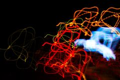 Abstract beautiful light painting photography, waves abstract light on black background. Slow shutter speed and blur-defocus technique stock images