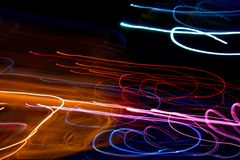 Abstract beautiful light painting photography, waves abstract light on black background. Slow shutter speed and blur-defocus technique stock photo