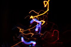 Abstract beautiful light painting photography, waves abstract light on black background. Slow shutter speed and blur-defocus technique stock photos