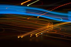 Abstract beautiful light painting photography, waves abstract light on black background. Slow shutter speed and blur-defocus technique stock photography