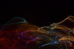 Abstract beautiful light painting photography, waves abstract light on black background. Slow shutter speed and blur-defocus technique royalty free stock photography