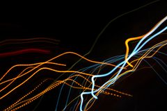 Abstract beautiful light painting photography, waves abstract light on black background. Slow shutter speed and blur-defocus technique royalty free stock images