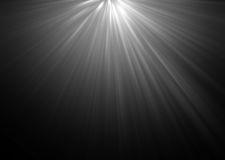 Abstract beautiful rays of light on black background. Royalty Free Stock Images