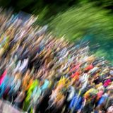 Abstract beautiful vivid colorful background. This greatly blurred crowd unrecognizable young people at concert, summer Stock Photos