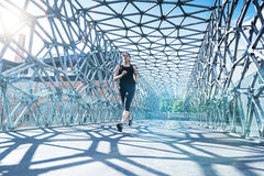Abstract - Beautiful woman running on a modern bridge Royalty Free Stock Photography