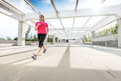 Abstract - Beautiful woman running on a modern metal bridge Stock Photos