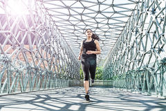 Free Abstract - Beautiful Woman Running On A Modern Metal Bridge Stock Image - 41483111