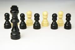 Abstract bedrijfsconcept met Koningsschaakstukken Stock Afbeeldingen