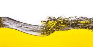 Abstract beeld van een gele gemorste vloeistof Stock Foto