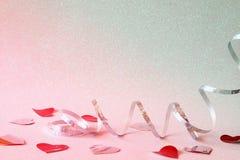 Abstract beeld van feestelijke lintdecoratie en harten Stock Foto's