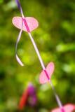 Abstract beeld van het hart op band op een achtergrond van groen Royalty-vrije Stock Fotografie